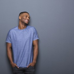 Portrait of a healthy african american man smiling on gray background